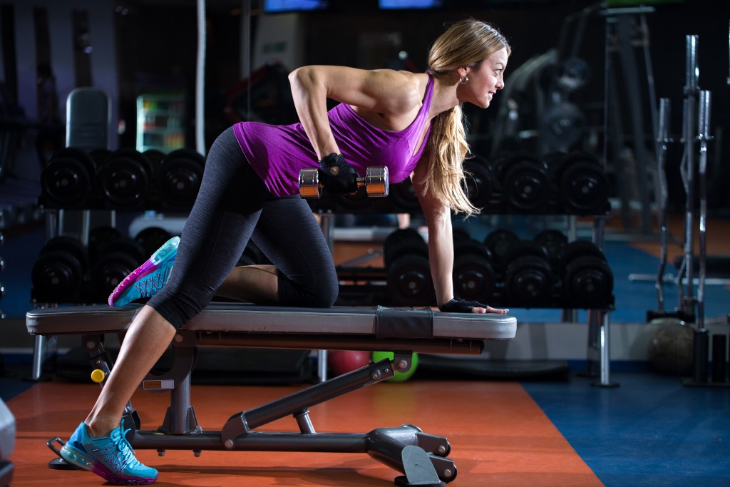 girl exercise triceps in gym