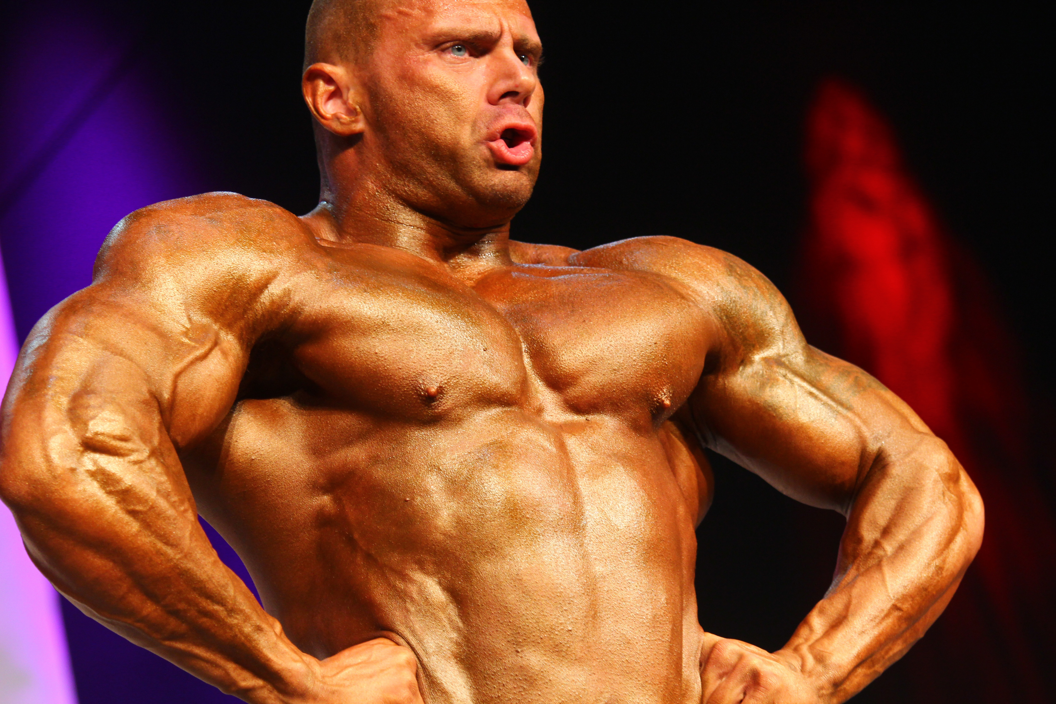 bodybuilder posing in a competition